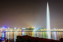 Geneva by night. Geneva water jet (le jet deau), night view in Leman Lake (Switzerland Royalty Free Stock Photo