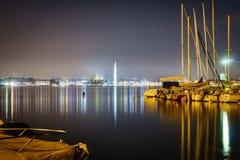 Geneva by night. Geneva water jet (le jet deau), night view in Leman Lake (Switzerland). Photo taken on: June 25, 2014 stock photo