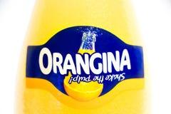 Geneva/Schweiz - 16 07 18: FlaskOrangina orange sodavatten Arkivbild