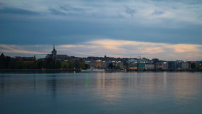 Geneva skyline day to night timelapse. Day to night timelapse of Geneva city, with the Lake Geneva in the foreground and the St Pierre Cathedral in the stock video footage
