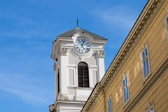 Geneva/Switzerland-28.08.18 : Bell tower clock building church time. Clock building in old town of Budapest Stock Photo