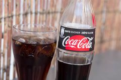 Geneva/Switzerland-28.07.18 : Glass bottle of Coca Cola sugar zero sugar free soda. Bottle of coca cola with a glasse with ice and lemon royalty free stock photography