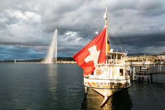 Geneva, Switzerland  - Jet dEau and old steam boat with swiss flag Stock Image