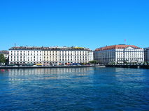 GENEVA, SWITZERLAND on JULY 2016: Hotels at Rhone River. GENEVA, SWITZERLAND, EUROPE on JULY 2016: White representative hotel buildings on city promenade at Royalty Free Stock Photography