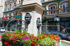 Geneva, Switzerland - June 17, 2016: Fountain at central street. And flower bed in Geneva, Switzerland stock photo