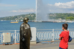 Geneva Switzerland :Man statue. Man statue in the English garden in front of big fountain royalty free stock photography