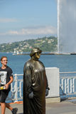 Geneva Switzerland :Man statue. Man statue in the English garden in front of big fountain stock images