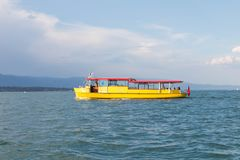 Geneva/Switzerland-28.08.18 : Yellow boat taxi tourist mouette lake royalty free stock photography
