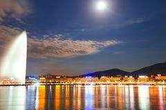 Geneva water jet. Geneva by night, switzerland ,waterfront, luxury brand, offices of multinational Royalty Free Stock Photos