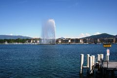 Geneva waterfront. By day, buildings and lighthouse Stock Images