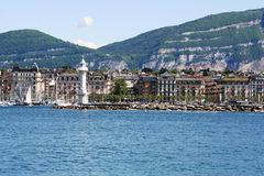 Geneva waterfront. By day, buildings and lighthouse Stock Photography