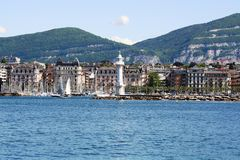 Geneva waterfront. By day, buildings and lighthouse Royalty Free Stock Photo