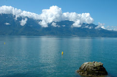 Geneve lake nearby La Tour-de-Peilz in Switzerland. Geneve lake and mountains nearby La Tour-de-Peilz in Switzerland royalty free stock photography