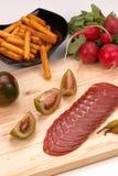 Genezen ruw varkensvleeslendestuk stock foto