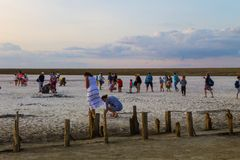 People gathering salt of pink salty Siwash Lake Royalty Free Stock Image
