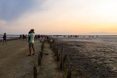 People gathering salt of pink salty Siwash Lake. Genichesk, Ukraine - August 23, 2017: People gathering salt of pink salty Siwash Lake, colored by microalgae Stock Photography