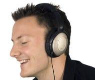 Genießen seiner Kopfhörer Stockbild