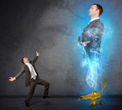 Genie business man appearing from magic lamp Stock Images
