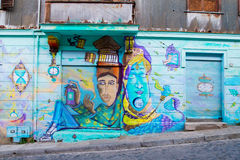 Genie Colourful portraits. VALPARAISO - NOVEMBER 07: Portraits on the wall of a house in the districts of the protected UNESCO World Heritage Site of Valparaiso Royalty Free Stock Photography