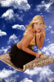 Genie on a flying carpet Stock Image