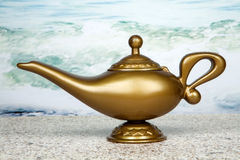 Genie Lamp. A genie lamp against an ocean background royalty free stock photo