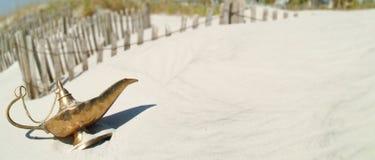 Genie Lamp on beach dune v1 Royalty Free Stock Image