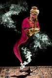 Genie and lamp. Fantasy genie with turban coming out of aladdin's oil lamp stock photography