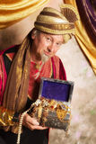 Genie with treasure chest Royalty Free Stock Photo
