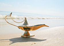 Genies lamp on seashore Stock Photo