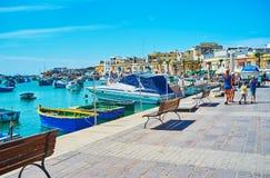 Geniet van de plaatsen in Marsaxlokk stock fotografie