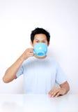 Geniet van een koffie royalty-vrije stock afbeeldingen