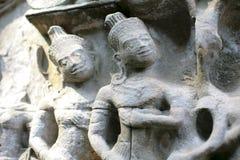 Geniet van standbeelden van Angkor-Tempel, Kambodja Stock Fotografie