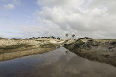 Genipabu Dunes in Natal, RN, Brazil. Genipabu or Jenipabu is a beach with a complex of dunes, a lagoon and an environmental protection area APA located close to Royalty Free Stock Photo