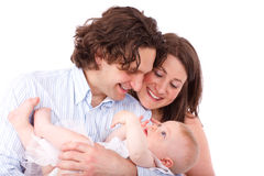 Genitori che tengono bambino Immagine Stock