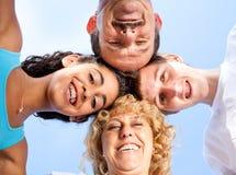 Genitori con i bambini che hanno divertimento all'aperto Immagine Stock Libera da Diritti