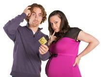 Genitori confusi con il preservativo Fotografie Stock Libere da Diritti