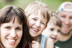 Genitori e figli Immagine Stock