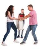 Genitori e figlia di combattimento Fotografia Stock