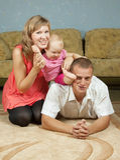 Genitori felici con il bambino Fotografie Stock Libere da Diritti