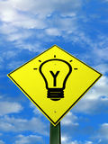Genius. A warning sign with a light bulb Royalty Free Stock Photo