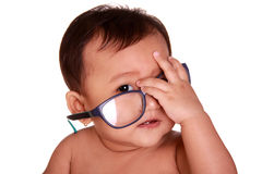 Genius baby wear glasses Stock Photography