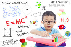 Genius boy. Portrait of genius boy trying to solve formula Royalty Free Stock Image