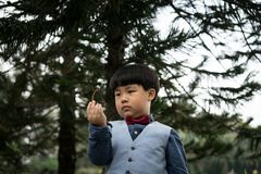 A genius boy observe environment. Genius kid observe environment around him in the garden Royalty Free Stock Images