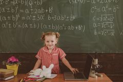Genius child have lesson in mathematics. Genius pupil in school. Math is functional, vintage filter royalty free stock images