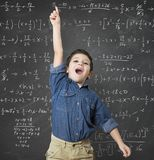 Genius child. Solves a mathematical calculation difficult Stock Photography