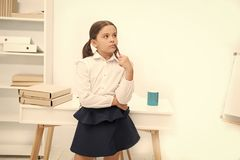 Genius concept. Genius girl lost in thoughts. Genius child solve problem. Genius pupil back to school. Use your brain.  royalty free stock image