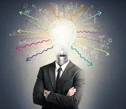 Genius. Concept of genius with illuminated light bulb in head royalty free stock photos