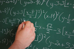Genius. The genius writes mathematical formulas on the board Royalty Free Stock Images