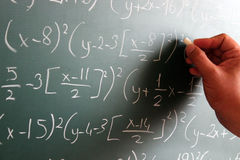 Genius. The Genius writes mathematical formulas on the board Royalty Free Stock Photos
