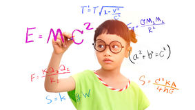 Genius girl. Little girl genius working on a mathematical equation stock photos